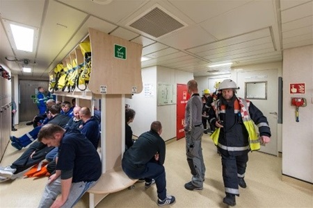 Employees on CNOOC International's Golden Eagle offshore platform in the UK participate in an emergency exercise.